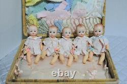 Madame Alexander Fisher Quintuplets Dolls come in a basket case with clothes
